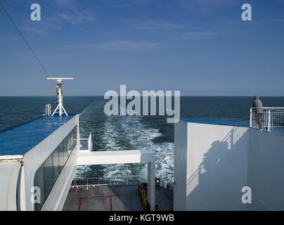 Distant view of the white cliffs of Dover from the stern of a channel ferry - Stock Image