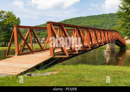 SMETHPORT, PA, USA-11 AUGUST A footbridge across Potato Creek, which feeds Hamlin Lake in Smethport. - Stock Image