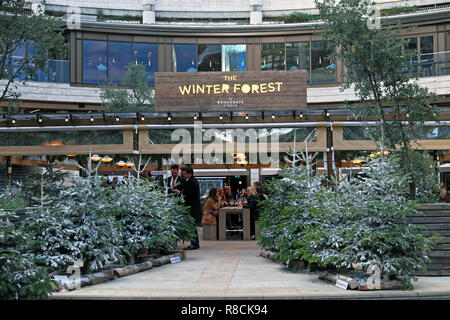 The Winter Forest bar and grill with Christmas trees at Broadgate Circle in The City of London England UK  KATHY DEWITT - Stock Image