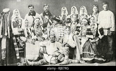 Group of men and women in traditional dress, with embroidery and jewellery, Republic of Estonia. - Stock Image
