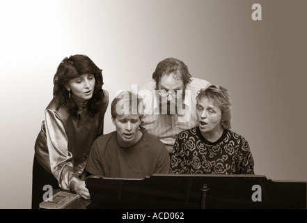 Singing together at the piano - Stock Image