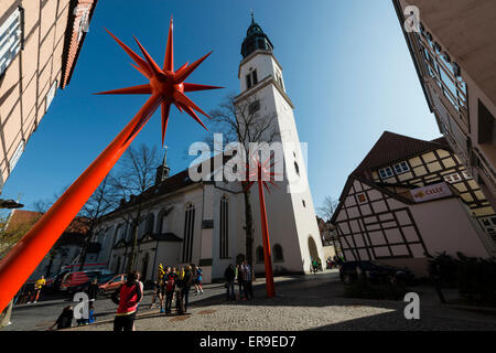 St. Mary church, red sculptures of Bomann museum in front, Lower Saxony, Germany - Stock Image