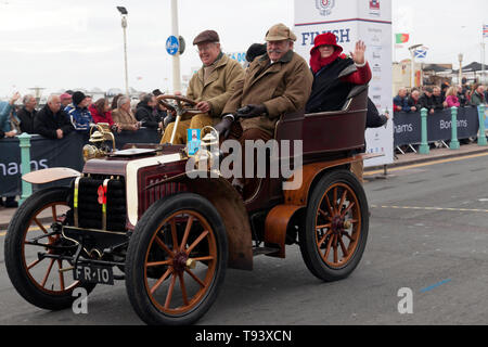 Mr Tim Dickson at the wheel of his 1902, Panhard Et Levassor, crossing the finishing line at the end of the 2018 London to Brighton Veteran car run - Stock Image
