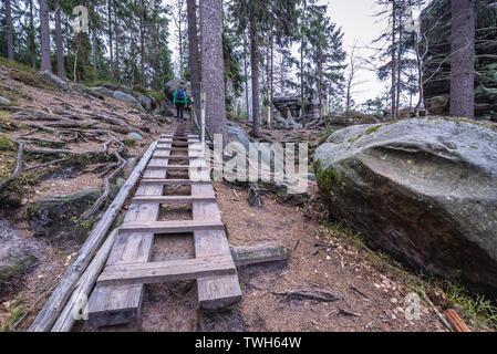 Hiking trail in Ostas Nature Reserve in Table Mountains range in Czech Republic - Stock Image