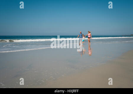 Caucasian family with toddler boy on the beach, Riviera Nayarit, Mexico - Stock Image
