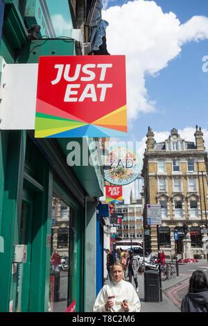 Just Eat signage on Borough High Street, Southwark, London, UK - Stock Image