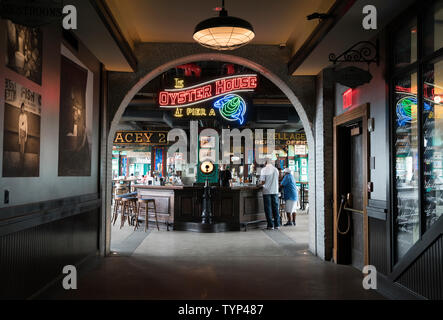 Pier A, a landmarked pier at the southern end of Battery Park City, is now home to a restaurant that specializes in seafood. The pier dates from 1886. - Stock Image