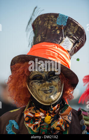 Venice, Italy. 25th Feb, 2014. A masked performer dressed as the Mad Hatter from Alice in Wonderland is pictured near San Marco (St Marks Square).Venice Carnivale Credit:  MeonStock/Alamy Live News - Stock Image