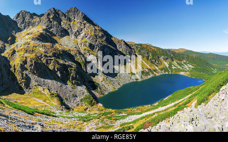 Panorama of Czarny Staw Gasienicowy and Maly Koscielec Peak surrounding from route to Skrajny Granat Peak, high Tatra mountains - Stock Image