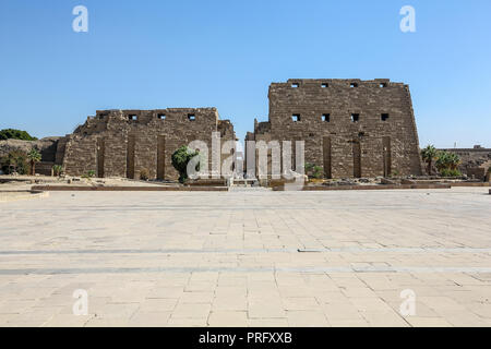 Tourists at the First Pylon at The Karnak Temple Complex, also known as The Temple of Karnak, in Thebes, Luxor, Egypt - Stock Image