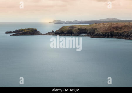 Moody light on sea and coastline of Pembrokshire, Wales, seen from coast path. - Stock Image
