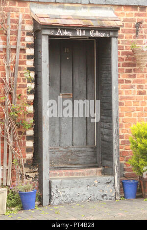 Grey front door of a cottage in Tewkesbury - Stock Image