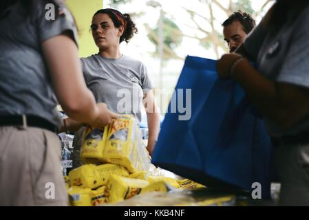 FEMA and AmeriCorps volunteers pack emergency supplies for Puerto Rican residents during relief efforts in the aftermath - Stock Image