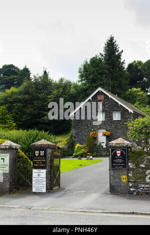 Entrance to the 16th century grammar school in the village of Hawkshead, Cumbria, the Lake District school attended by the poet William Wordsworth. - Stock Image