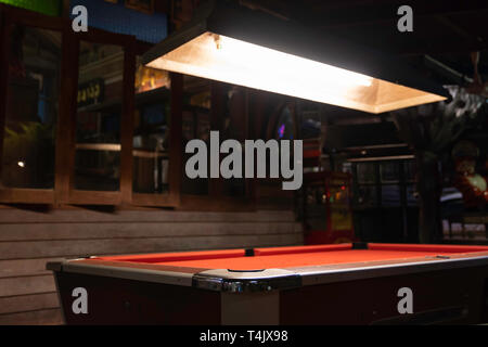 Vintage pool table in night club, pool snooker billiard concept background. - Stock Image