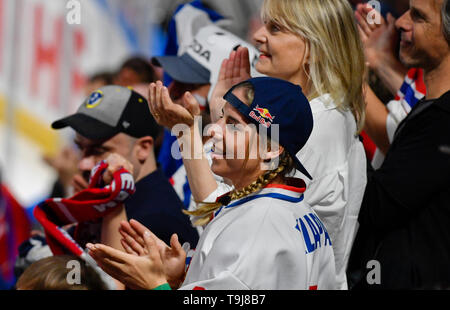 Bratislava, Slovakia. 19th May, 2019. Czech snowboarder and skier Ester Ledecka, with her parents Zuzana Ledecka and Janek Ledecky watch the match between Austria and Czech Republic within the 2019 IIHF World Championship in Bratislava, Slovakia, on May 19, 2019. Credit: Vit Simanek/CTK Photo/Alamy Live News - Stock Image