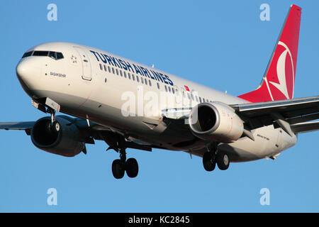 Commercial air travel. Turkish Airlines Boeing 737-800 passenger jet plane on approach. Closeup front view. - Stock Image