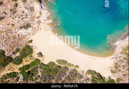 Bird View of Amazing Tris Klisies Bay in Ios Island, Cyclades, Greece. Spectacular bay for relaxing and enjoying the quite, beautiful nature of Ios Is - Stock Image