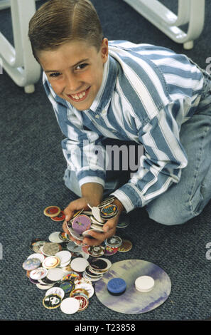 7 Year Old Boy Collecting Milk Pogs, USA - Stock Image