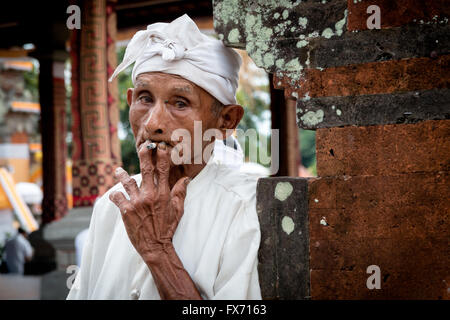 smoking man in Bali - Stock Image