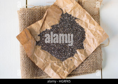 Chia seeds on wooden table - Stock Image