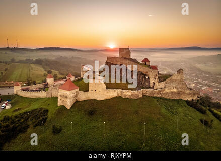 Rupea citadel at sunrise in Transylvania tourist travel attraction situated between Brasov and SIghisoara - Stock Image
