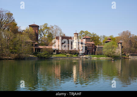 TURIN, ITALY - MARCH 31, 2019: Borgo medievale, medieval village and castle with Po river in a sunny day, man with canoe in Piedmont, Turin, Italy. - Stock Image