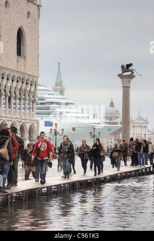 Cruise ship 'Costa Favolosa'  passing the St. Mark's Basin (Bacino di San Marco) during acqua alta, - Stock Image