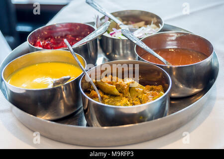 Selection of sauces, chutneys and pickles for poppadums, Spice Masala indian restaurant, formerly Kismet Tandoori, Chipping Ongar, Essex, England - Stock Image