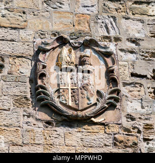 Carved stone coat of arms, showing lions rampant, on a wall of Durham cathedral, England, UK - Stock Image