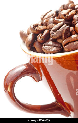 Closeup Of Coffee Beans In A Cup - Stock Image