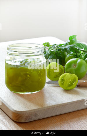 Jam or chutney in a glass jar made of green tomatoes, home canning concept - Stock Image