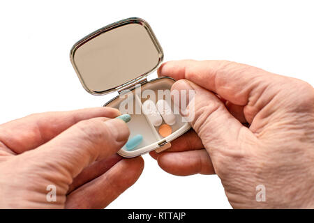 A handy small pill box for holding medical pills and tablets - Stock Image