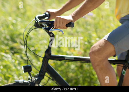 close up of man riding bicycle outdoors - Stock Image