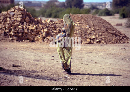 A Bhil tribe woman in brightly coloured dress, Rajasthan, India. - Stock Image