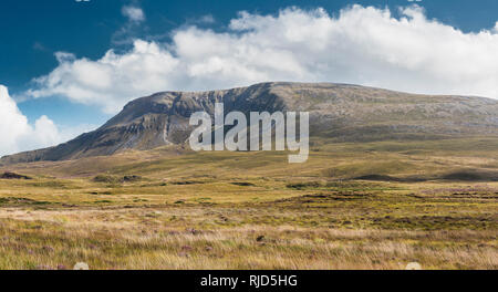 View across bogland towards Muckish Mountain with its large glacial corrie, from bogland near Falcarragh, County Donegal, Ireland - Stock Image