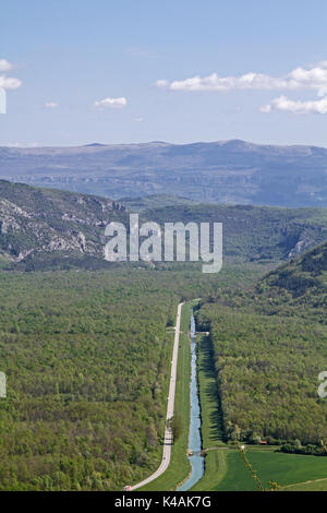 Straight Cord Runs Street And Flow Through The Mirna Valley Towards Cikarija Mountains - Stock Image