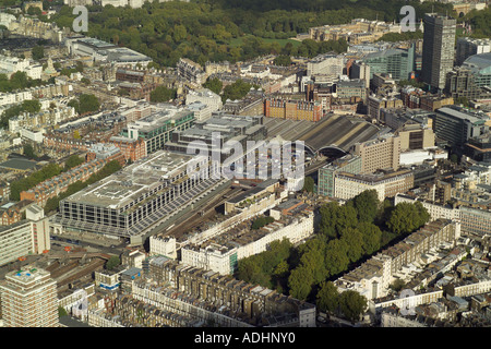 Aerial view of Victoria Station with Victoria Place Shopping Centre in the foreground and Buckingham Palace in the background - Stock Image