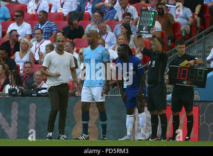 Manchester City Manager Pep Guardiola and Vincent Kompany during the FA Community Shield match between Chelsea and Manchester City at Wembley Stadium in London. 05 Aug 2018 - Stock Image