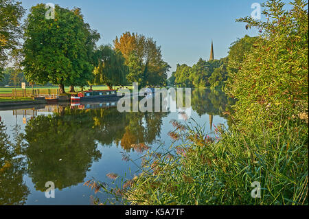 Stratford upon Avon and early morning reflections on the River Avon, with the view Holy Trinity church, burial place of William Shakespeare. - Stock Image
