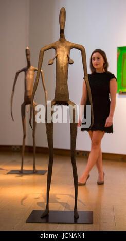 London, UK. 16 June 2017. A Christie's employee looks at the Antony Gromley sculptures Inside Australia Prototype - Stock Image