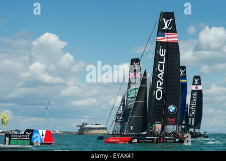 Portsmouth, UK. 25th July 2015. All six AC45f catamarans head for the line at the start of the second race. Credit: - Stock Image
