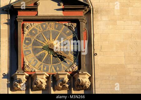 Close-up view of historical clock on Saint-Jean cathedral façade, Lyon, France - Stock Image