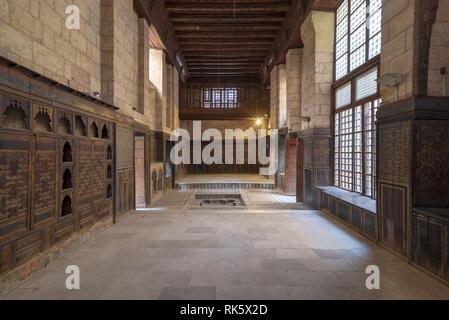 Hall at ottoman era historic house of Moustafa Gaafar Al Seleehdar located at Al Darb Al Asfar, Cairo, Egypt with decorated wooden ceiling, marble dec - Stock Image