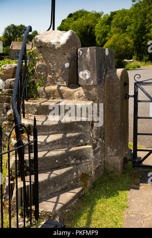 UK, Yorkshire, Wharfedale, Linton Falls, St Michael and All Angels church, steps and narrow stile at Church Road gate - Stock Image
