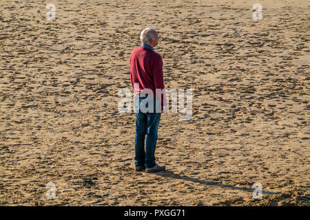 Man,Deep in thought,Looking out to Sea,Deserted Beach,Lonely,Middle Age,Pensioner - Stock Image
