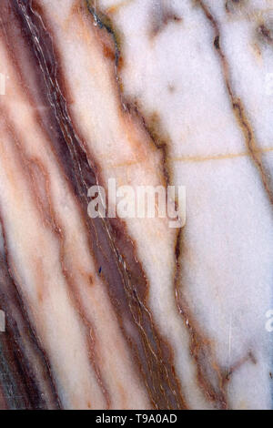 Gorgeous colorful marble surface in a closeup photo. Luxurious material to be used in buildings. There is colorful abstract shapes. - Stock Image