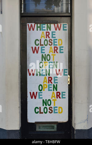 Funny shop opening sign. Hastings old town, East Sussex, England, UK - Stock Image