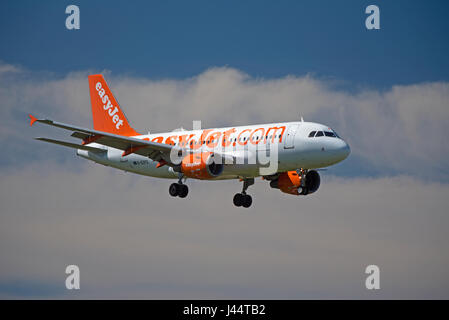 Easyjet commercial passenger Airbus A 320-214 aircraft in its unmistakeable company orange livery - Stock Image
