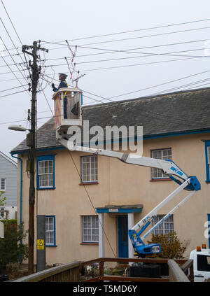 Workers for Western Power Distribution working to replace telegraph poles and electricity cables in Sidmouth, Devon, UK - Stock Image